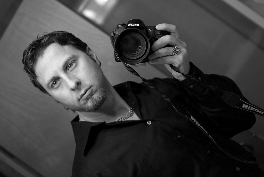 """<h2 class=""""notopmargin"""">Bio</h2>  <p>I'm Logan Ramsey the principle photographer at The Radiant Image; I became interested in photography around age 13 when I was giving camera for a present, instantly becoming hooked on capturing the moments in time from behind the view finder, constantly improving my skills by studying the latest techniques, experimenting with color negative, chrome, B&W films, lighting and filters, even taking college courses in photography. As times have changed I have gone completely digital leaving films and photo processing chemicals behind, embracing the fast paced ever changing techniques, equipment and trends. I love perfecting my skills today as much or more than the year's gone bye, continuing to build my expertise photographing Weddings, doing creative portraiture, editorial, and commercial photography. I relish the creative process and working with new people, it literally feeds my soul! For me it's not about how much a client spends, but instead it all about harmonizing with the client's wishes, striving for excellence, and delivering Radiant Images that exceed expectations. Let us capture your moments with Radiant Images! </p> <h3><strong><center>Let us capture your moments with Radiant Images!</h3></strong></center> <h3><strong><center>Call us: 612-940-9245</h3></strong></center>"""
