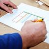 Carpenter making drawings