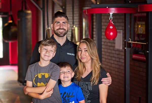 Hometown News - 9 Round Kickboxing - Justin Richardson and Meriem Klawonn (Co-Owners) with the kids Emmet 7 and Hudson 4