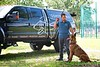 Hometown News - Coastline K-9 Erick Innis with Shadow (that'd be the black dog) and Loki both are Belgian Malinois