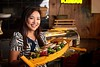 Hometown News - Hana Sushi Lounge Jane Dokko (owner) - Holding the Sushi Boat
