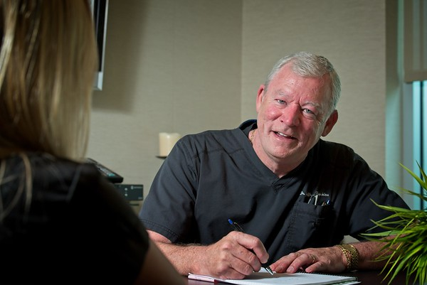 Hometown News - Jeffrey T. Hawkins DDS during a consult with a potential Patient.