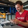 iHeart Repair Tech Brenton Graber works on a broken iPhone 4s