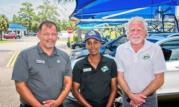 Photo by: Mark M. Odell credit: OdellPhotos.com - Jax Car Wash -Robert Graves (gen mgr)<br /> Shanise Brown (mgr) with Tony Milen Owner
