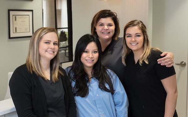 in black LtoR - Cassidy Gilley Office coord - Morgan Merritt - Dental Asst - Savanna King Dental Asst - with Dr. LoanAnh Bui DDS in blue