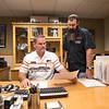 L Scott Kessler (General Manager) and Jimmy Manns (service Advisor) lookig over some paperwork in Scotts office.