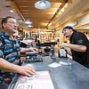 R Eric Beasley (Parts Sales) heling Customer Brad Junge of Bradenton