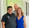 Hometown News - John and Lesana Holly with store manager Miguel Angel Sanchez, Pia Esthetics Day Spa (Dec Cover Owner)