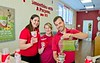 Hometown News - Smoothie King - group shot not holding anything LtoR Stephanie Strait Asst Mgr, Sarah Morgenson Gen Mgr of store on 70 and owner Chris Thomas