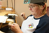 Gemz Fine Jewelry - Sheryl Davis (Owner) Jeweler Cyndee Boelkins working on a watch to replace a battery and some inset stones