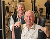 John and Holly Barry, both eight year members of 20 Minutes to Fit pose near the Torso Rotation Machine.  Member profile image.  Photo by OdellPhotos.com on 12-19-13 For Hometown News