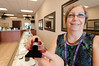 Gemz Fine Jewelry - Sheryl Davis (Owner) holding a 14kt Rose Gold Ring w/ 5.40 Ct Emerald Cut Morganite Gemstornes with .25 ct. Diamond Ring