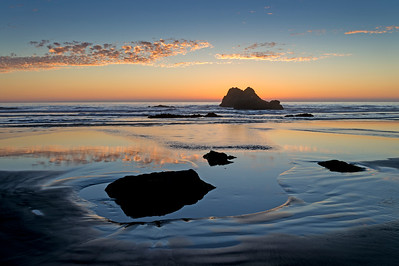 Coastal Rocks and Reflections in Evening Twilight