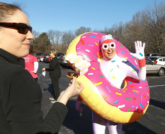 "DENISE FEDOROW | THE GOSHEN NEWS<br /> Jen Pauls, a  participant in Saturday's ""Donut Run for Ryan's Place"" in Middlebury dressed the part for the event."