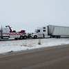 A towing company pulls a semi-tractor trailer out of the median on I-57, near the 163 mile post. Dawn Schabbing photo