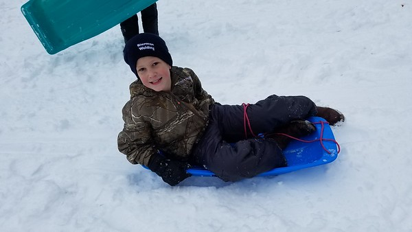 Will Bierman,10, Effingham bends his direction gently as he slides down the hill at Community Park Saturday.