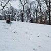 Mia Kinkelaar sleds down the hill behind Liv Hoene on Saturday at Community Park. Dawn Schabbing photo
