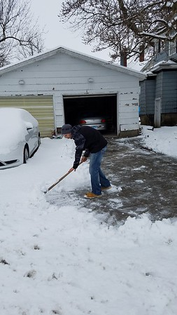Anthony Miah, 22, shovels the driveway at his home in Neoga on Saturday. Dawn Schabbing photo