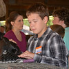 Kendall Meyer preps his New Zealand rabbit before showing it during the 4-H rabbit show Wednesday morning at the Effingham County Fairgrounds in Altamont. Kaitlin Cordes photo