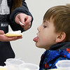 Five-year-old Joel Macklin sticks his tongue out for a taste of icing as his sister Evie, 10, frosts his cookie during Hometown Christmas.<br /> <br /> Chet Piotrowski Jr. photo/Piotrowski Studios