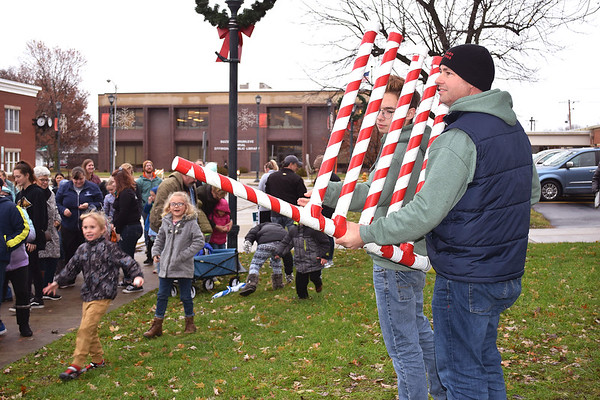 Evan and Michael Williamson aim a leaf blower full of ping pong balls into the crowd during the snowball drop.
