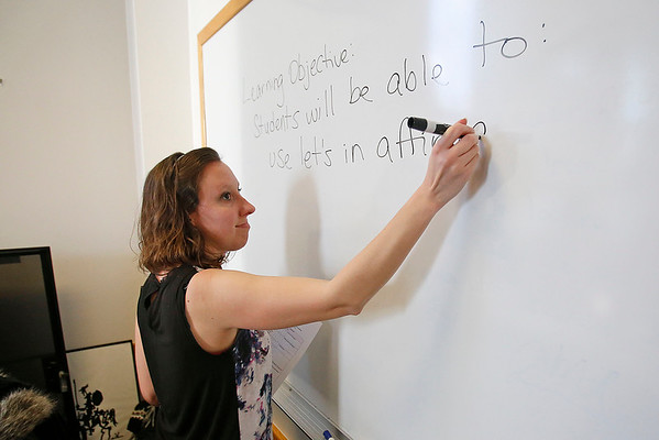 MICHAEL CATERINA | THE GOSHEN NEWS<br /> English language teacher Elisabeth Federinick writes an assignment on the board during a class at Goshen College March 16, 2016.