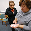 MICHAEL CATERINA | THE GOSHEN NEWS<br /> English language students Margarita Canales and Gabriella Suarez work on an activity matching nouns and verbs during a class at Goshen College March 16, 2016.