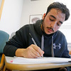 MICHAEL CATERINA | THE GOSHEN NEWS<br /> English language student Hugo Esparza works on an assignment during a class at Goshen College March 16, 2016.