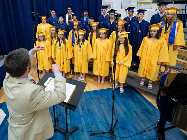 Fairfield's Choir Director Ben Kambs, left front, directs the senior choir during Sunday's Fairfield High School Class of 2021 Commencement in Benton.