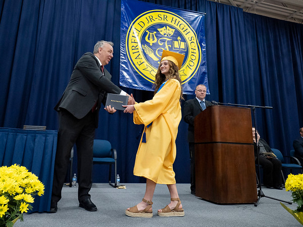 Fairfield's Madelyn Yoder, right, receivers her diploma  during Sunday's Fairfield High School Class of 2021 Commencement in Benton.