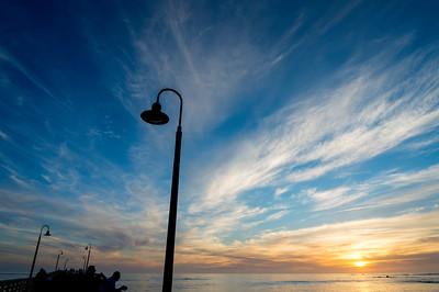 Sunset_at_Busy_Coastal_Pier_KKD7479