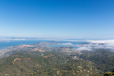 Marin Headlands with Oakland, San Francisco, CA, and Bay Bridge (in the distance behind clouds).  Also in the photo in the center is Angel Island State Park (slightly left) & Alcatraz Island (slightly right).  Photo shot on East Peak near or along the trail up to East Gardner Fire Lookout. Mt. Tamalpais State Park - Marin County, CA, USA