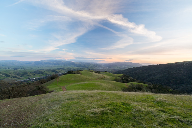 Sunset. Interstate 680 (right) & Sunol (in the distance). Small unmarked trail near Ridgeline Trail - Pleasanton Ridge Regional Park - Sunol, CA, USA