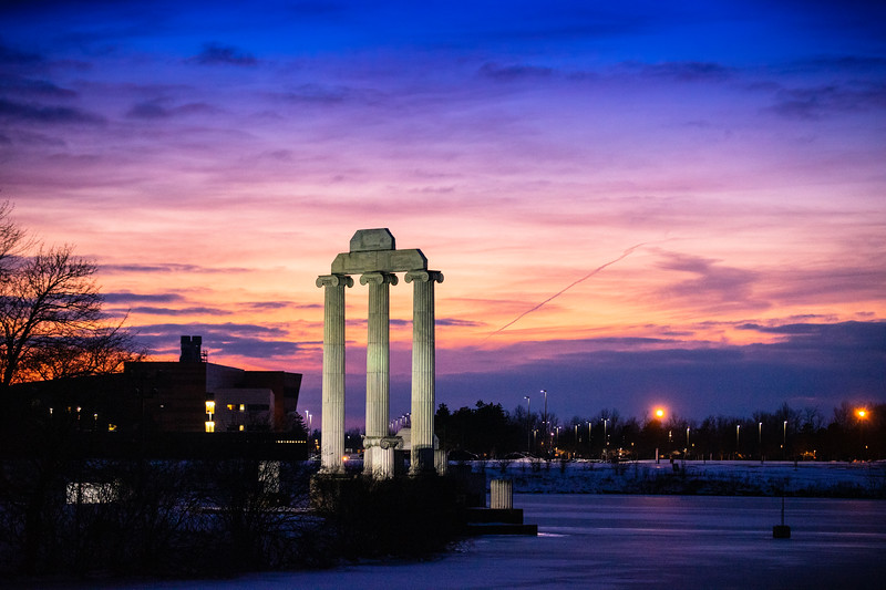 A winter sunset over North Campus, including Baird Point and Lake La Salle, in February 2020. <br /> <br /> Photographer: Douglas Levere