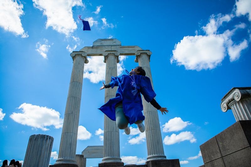 Rutuja Sawant poses for photos at Baird Point on North Campus to celebrate her graduation from the College of Arts and Sciences on May 16, 2020. The graduation ceremony was moved to a virtual presentation because of the COVID-19 response. <br /> <br /> Photographer: Douglas Levere
