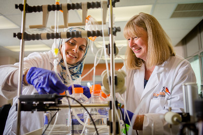 Cancer research company, For Robin, with founder Rittenhouse-Olsen in her Sherman Hall lab.  Photographer: Douglas Levere