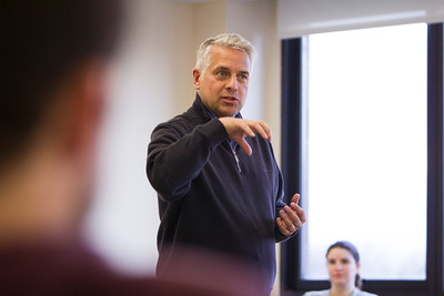Marc Adler teaching an honors marketing class in Capen Hall  Photographer: Douglas Levere