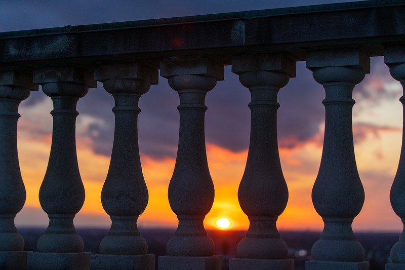 The sun sets over South Campus as seen through balusters in April 2020.<br />  <br /> Photographer: Douglas Levere