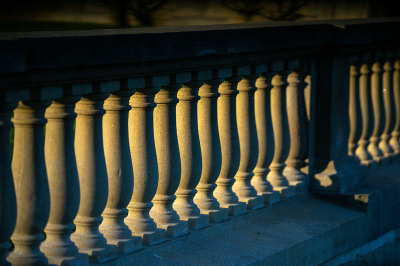 The setting sun casts shadows the balusters South Campus in April 2020.<br />  <br /> Photographer: Douglas Levere