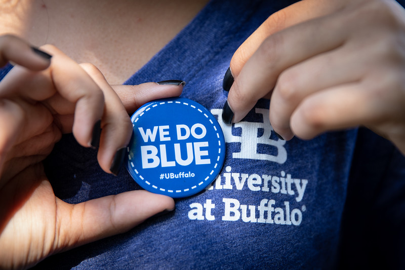 Get Blue button and other gear product shots near Crofts Hall in August 2019.<br /> <br /> Photographer: Meredith Forrest Kulwicki
