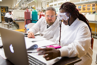 Prof. Jason Benedict works with students in the lab.  Physical chemistry lab with students in the Natural Sciences Complex.  Photographer: Meredith Forrest Kulwicki