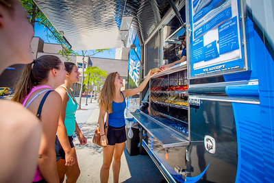 Students at the Little Blue food truck by the Student Union on North Campus  Photographer: Douglas Levere
