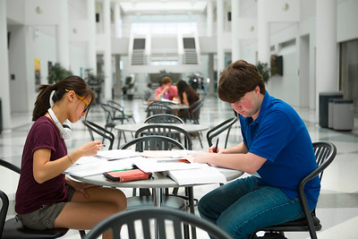 Students studying in Center for the Arts atrium