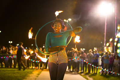 Carnival and bonfire by Lake LaSalle on North Campus during Homecoming weekend  Photographer: Doulgas Levere