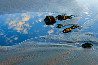 Coastal Beach and Cloud Reflections