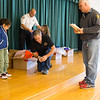 JOED VIERA/STAFF PHOTOGRAPHER-Lockport, NY-  Lockport City Firefighters  give students coats during Operation Warm at Charles Upson.
