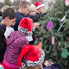 JOED VIERA/STAFF PHOTOGRAPHER-Gasport, NY-Roy-Hart students place gift requests written on mittens on the Christmas tree in front of the Gasport Post Office.