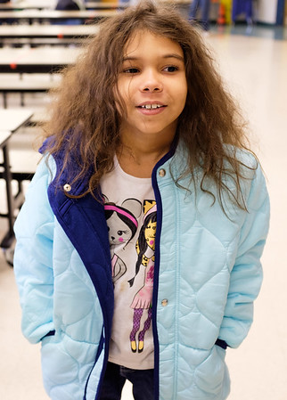 JOED VIERA/STAFF PHOTOGRAPHER-Lockport, NY-  Lillian Brister tries on her new coat at Charles Upson.