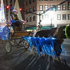 JOED VIERA/STAFF PHOTOGRAPHER-Lockport, NY-    A Miniature horse leads its handler in the Light Up Lockport Parade.