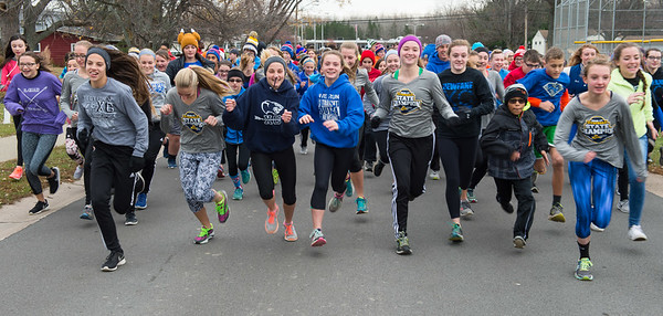 JOED VIERA/STAFF PHOTOGRAPHER-Newfane, NY- The Newfane High School Girls cross country team lead Newfane middleschoolers in Wednesday's Turkey trot  right after being presented the NYSPHSAA Class C Championship Award during a ceremony at the Middle School.